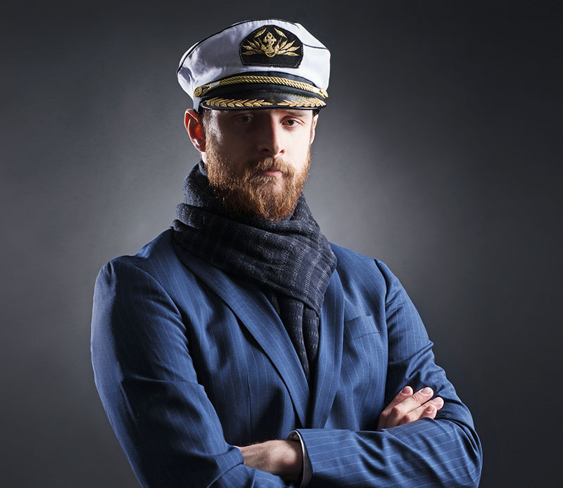 Portrait of a handsome sailor on a dark background